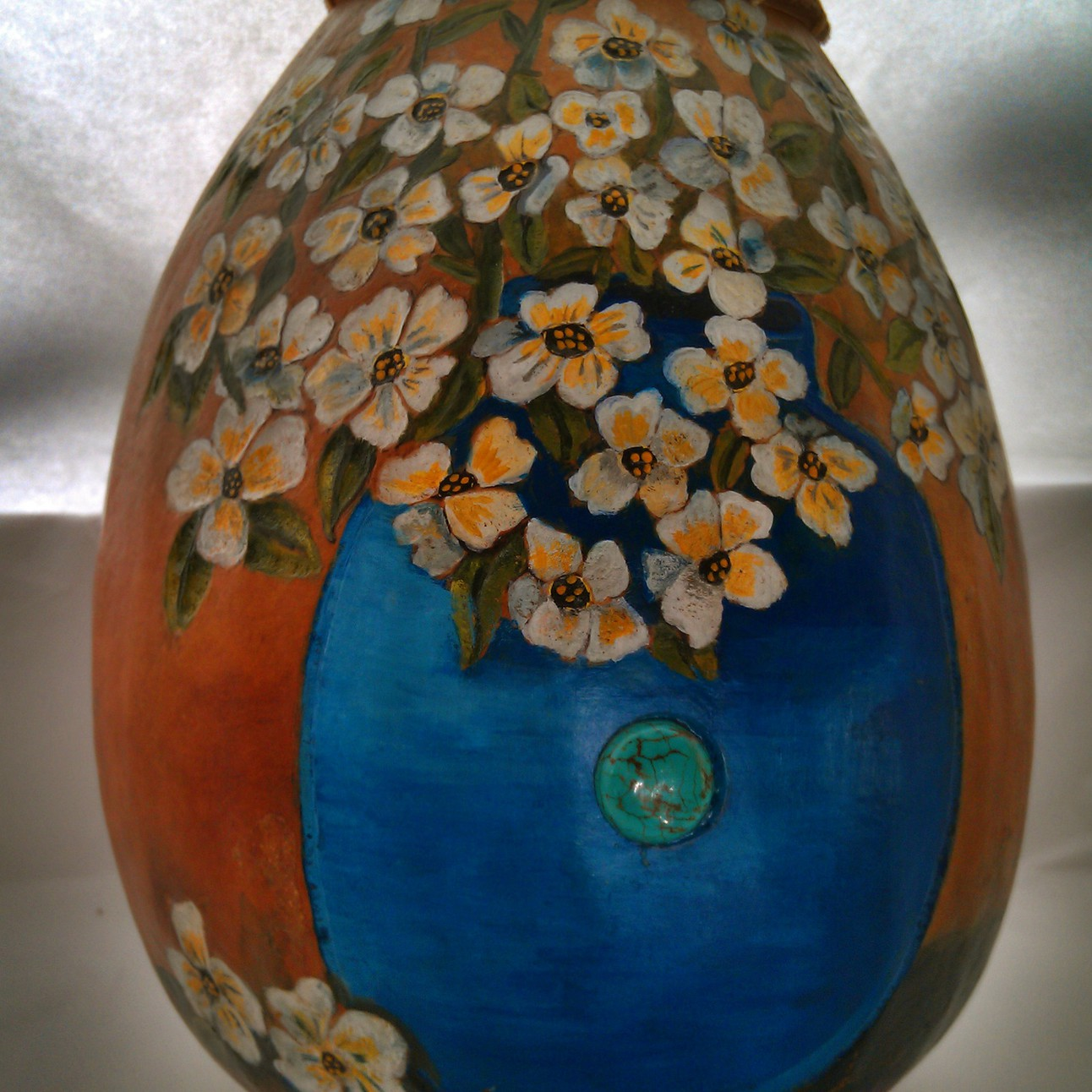 Dogwood flowers vase is embelleshed and relief hand carved gourd